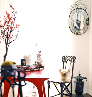 Love the funky table and mirror...