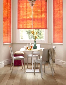 Bright colored paper shades as pretty much the only splash of color in a dining room- love it!