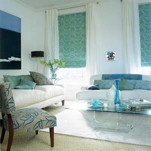 Patterned shades flanked by white curtains and walls- love!