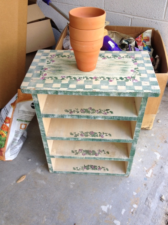 I'm going to repaint this shelf and use it in the bathroom. The 3 mini flower pots were 25 cents total-- perfect for my kitchen window garden!