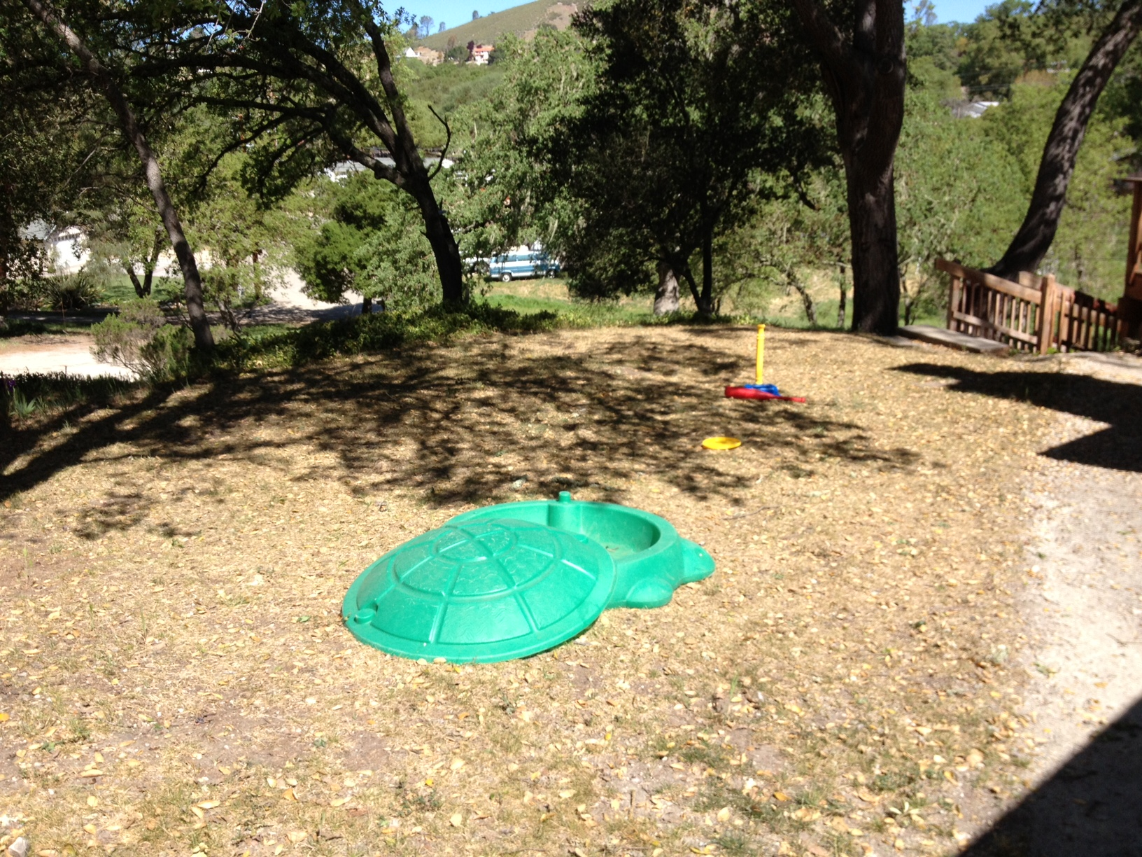 This is the right side of our house as you face it from the front. Eventually this will be the boys' play area, with a picket fence around the perimeter. We have Gregory's (empty) sandbox and his baseball tee so far. Should we add a playground? A water activity table? This area is too shaded to support much of a lawn, so that's out